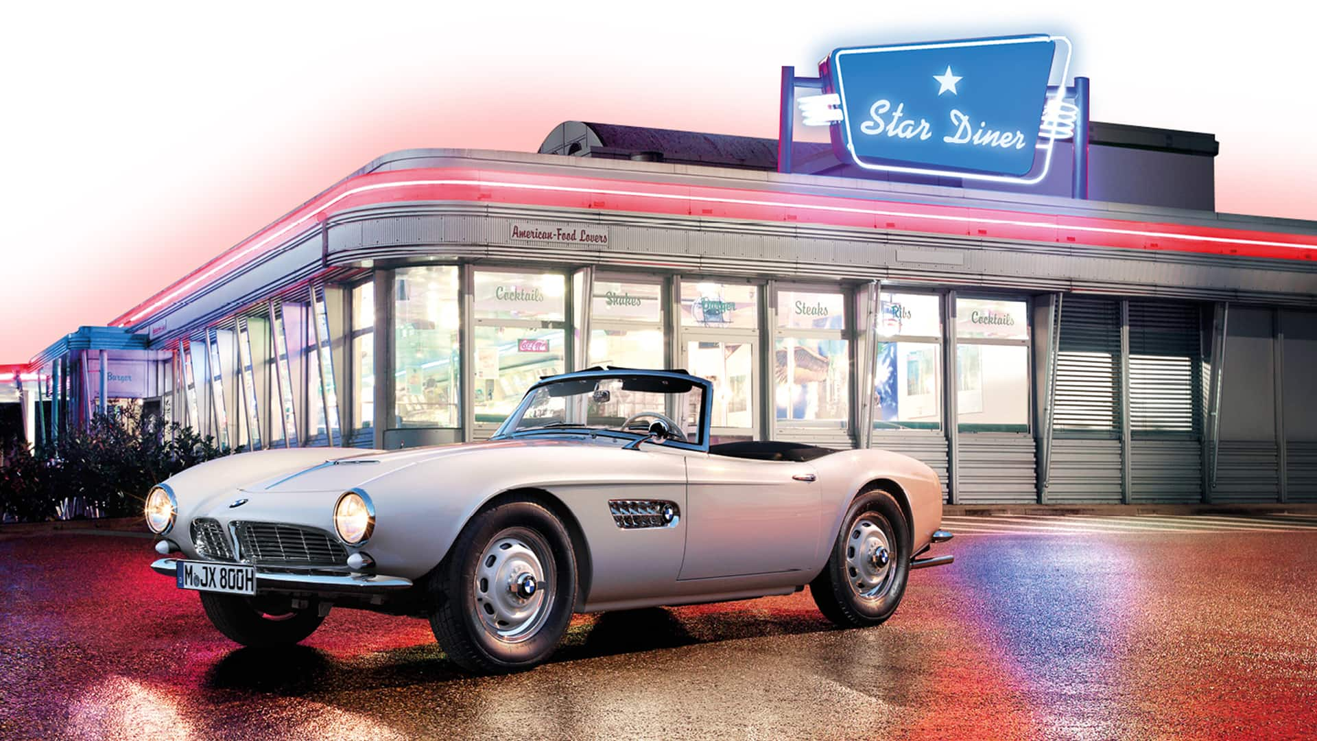 Restored Elvis BMW 507 in front of a diner